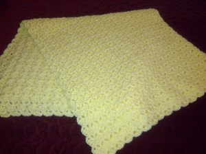 Just completed this baby blanket for my newborn granddaughter. She looks so beautiful in yellow.