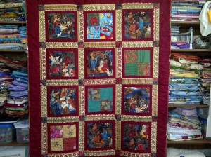 Quilt just finished. It had 70 thread tails to be worked in. I had to thread that needle 70 times!
