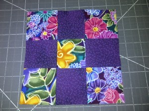 I decided to give it some pizazz by adding a nine-patch block at each corner.