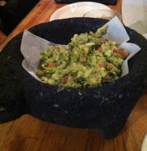 avocados, guacamole in a molcajete