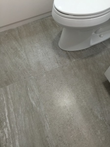 Love my new floor in my gray and white bathroom.